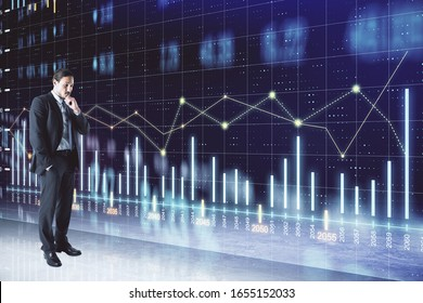 Thinking businessman standing near glowing stock analytics on virtual screen. Global business and information technology concept