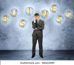 Thinking businessman with word business
