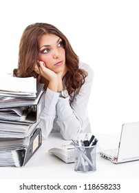 Thinking businesswoman sitting behind the desk in the office
