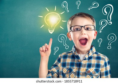 Thinking child boy with light bulb and question marks. Brainstorming and idea concept