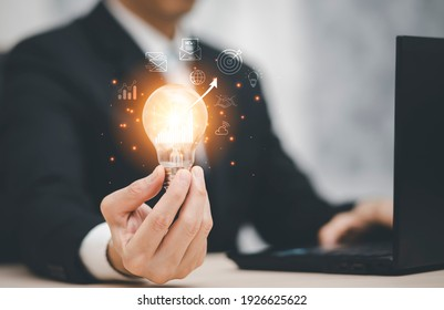 thinking and creative concept, Close up the light bulb and working on the desk, Creativity, and innovation are keys to success,  new idea and innovation with Brain and light bulbs, working at home