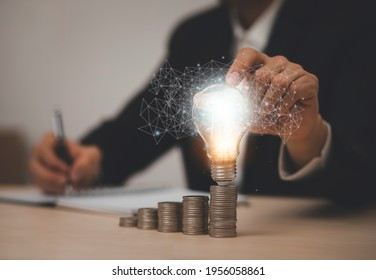 thinking and creative concept, Close up light bulb and working on the desk, Creativity and innovation are keys to success.Concept of new idea and innovation with Brain and light bulbs, working at home