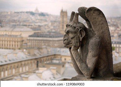thinking figure called Chimera or grotesque and the Panorama of Paris in France from Bell tower of Basilica of Notre Dame