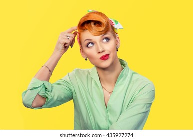 Thinking girl. Portrait closeup funny confused skeptical woman girl female thinking trying to recall looking upwards isolated yellow wall background. Human expressions emotions feelings body language