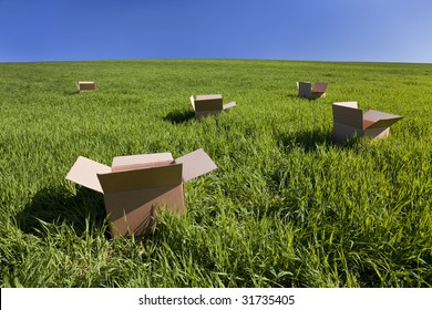 Thinking outside the box concept shot shot on location showing five empty boxes in a green field with a blue sky