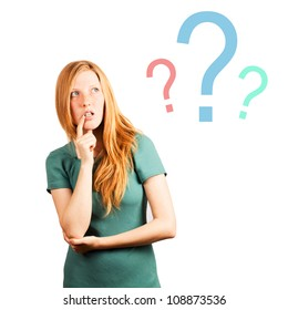 "thinking red-haired girl isolated on a white, looking at questions marks. posing ""don't know"""