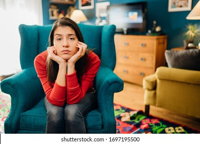 Thinking sad woman in bad mood overthinking problems.Bored staying at home.Quarantine mental health effect.Self-isolation emotional challenge.Having an idea.Creative block - Shutterstock ID 1697195500