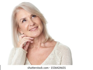 Thinking senior woman looking up isolated on white background