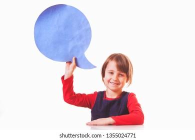 I am thinking of something. Portrait of happy laughing little child girl with thinking bubble blackboard background.