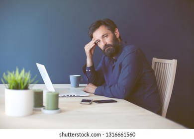 Thinking, tired or ill with headache self-employed at his home office