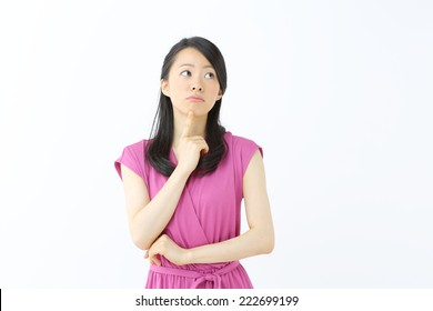 thinking woman looking up, isolated on white background
