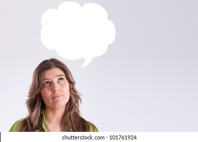 Thinking woman with thought bubble with copy space