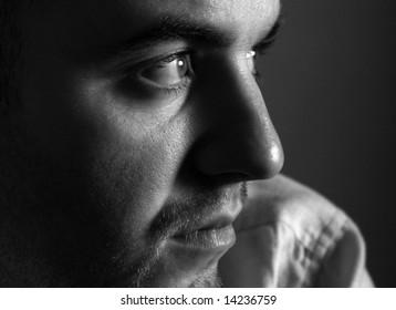 thinking young man bw closeup