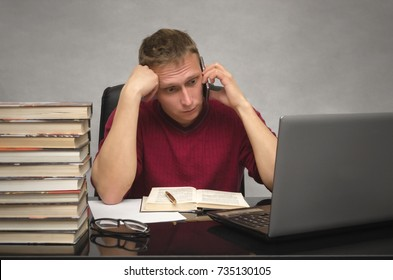 A thinking young student sits at desk table and pensive looks at laptop screen. Wistful business man talking on mobile phone in office.