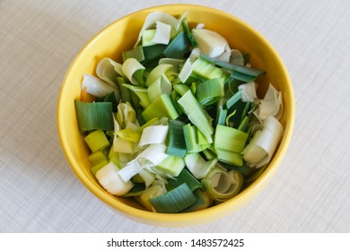 Thinly sliced leek in a bowl before cooking