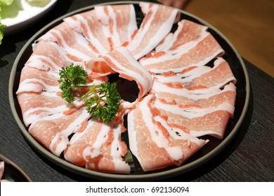 Thinly sliced of raw pork for Japanese hot pot also known as Shabu Shabu or Sukiyaki is Japanese style.
