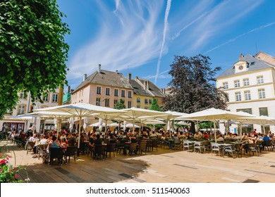 THIONVILLE ,FRANCE - JUNE 10, 2016: Full cafe beer restaurant terrace in center of old french city of Thionville, France with couples, friends and families drinking, eating