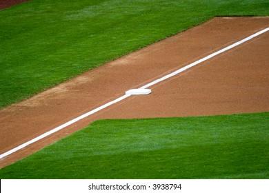 Third base with a white caulk line