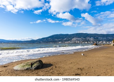 Third Beach, Stanley Park Seawall. West Vancouver cityscape in the background. British Columbia, Canada.