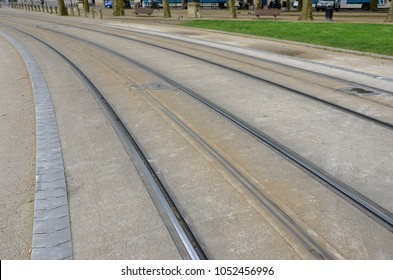 Third central rail between the running rails of the Bordeaux's modern tramway