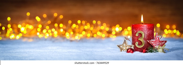third sunday in advent concept xmas light wooden wide panorama background with candles ball bauble stars