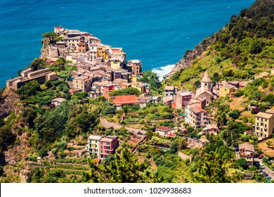 Third village of the Cique Terre sequence of hill cities - Corniglia. Sunny spring morning in Liguria, Italy, Europe. Picturesqie seascape of Mediterranean sea. Traveling concept background.