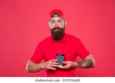 Third wave of coffee is movement to consume enjoy and appreciate high quality coffee. Alternative concept. Cafe barista hold coffee cup. Coffee to go. Cafe stuff red uniform with cap serving drink.