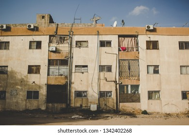 third world country poor dirty slum house facade in vintage old style photography in ghetto Middle East district