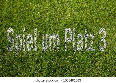 Third-place play-off (in german) written on soccer meadow