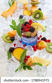 thirst quenching glass with cold water and fresh summer fruit with ice