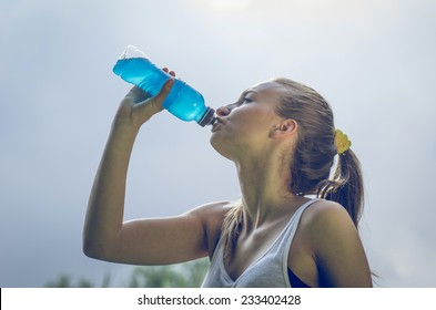 thirsty athlete drinking power drink after long run