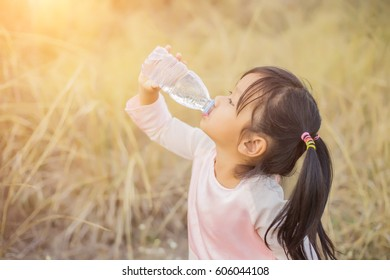 Thirsty Girl Drinking Water Outdoors