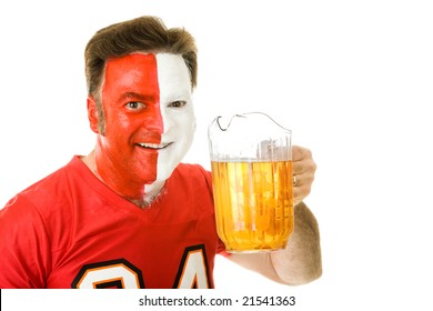 Thirsty sports fan with painted face, holding a pitcher of beer.  Isolated on white.