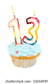 Thirteenth birthday cupcake with blue frosting on a white background