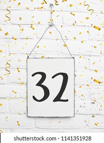 Thirthytwo 32 years old birthday congratulations text with golden confetti anniversary number 32