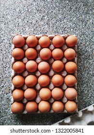 Thirty brown eggs in market carton package, top view