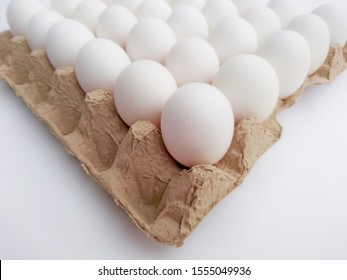 Thirty chicken eggs in egg carton angle view isolated on white background. Whole eggs in market carton box. Poultry eggs in carton paper tray package - healthy food breakfast cooking nutrition concept