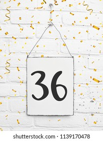 Thirty six years old birthday congratulations text with golden confetti number 36