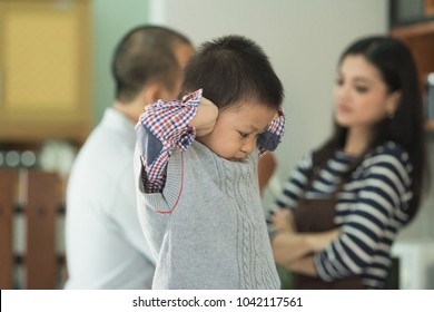 Thirty something couple at home fighting with son between them