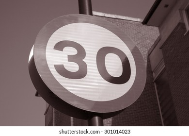Thirty Speed Sign against Sky Background in Black and White Sepia Tone