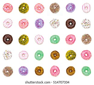 Thirty sweet colorful donuts on a white background