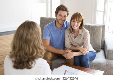 Thirty year old couple meeting financial adviser for investment