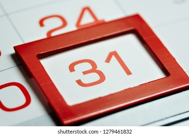the thirty-first day of the month highlighted on the calendar with a red frame close-up macro, the mark on the calendar, the thirty-first date