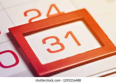 the thirty-first day of the month highlighted on the calendar with a red frame close-up macro, the mark on the calendar, the thirty-first date, toned, light, bright