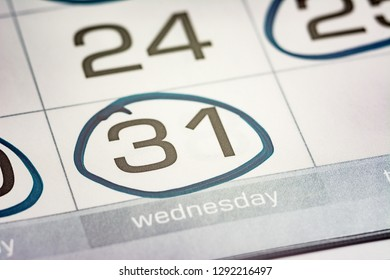 the thirty-first day of the month highlighted on the calendar with a round frame close-up macro, the mark on the calendar, the thirty-first date