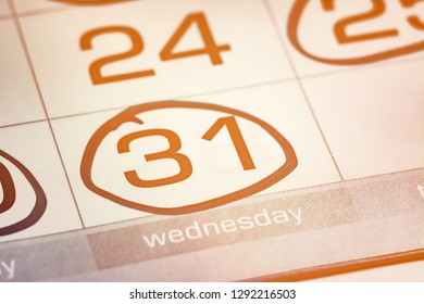 the thirty-first day of the month highlighted on the calendar with a round frame close-up macro, the mark on the calendar, the thirty-first date, toned, bright, light