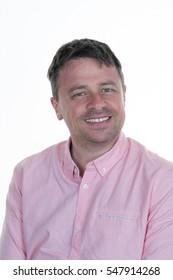 A thirty-year-old man in pink shirt on a white background