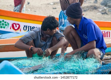 Thiruvallur District Ennore in North Chennai, Talangkuppam Fishermen Village Boat Yard,Tamil Nadu in India, December 31, 2017: Fishermen activities of man and woman Fisherman at the seashore