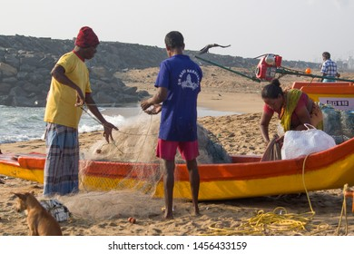 Thiruvallur District Ennore in North Chennai, Talangkuppam Fishermen Village Boat Yard,Tamil Nadu in India, December 31, 2017: Fishermen activities of men and women Fishermen at the seashore
