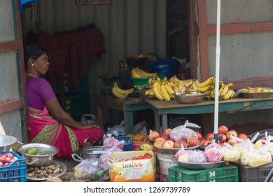 Thiruvallur District Ennore – Talangkuppam Fishermen Village, Tamil Nadu India, December 28, 2018: A Man and Woman Selling Fruits and Ornaments at Talangkuppam Market